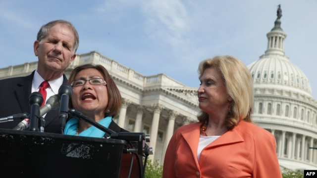 Human trafficking survivor Shandra Woworuntu (C) speaks during a news conference with U.S. House of Representatives Victims' Rights Caucus Chairman Rep. Ted Poe (L) and Rep. Carolyn Maloney outside the U.S. Capitol May 20, 2014 in Washington, DC.