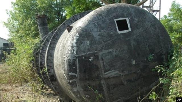 MIC storage tank 610 which overflowed, causing fatal gas leak