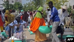 FILE - Somali internally displaced people receive food aid donated by a Qatari charity during the holy Muslim month of Ramadan in Mogadishu, June 20, 2015. Somalia's federal government has said it will stay neutral in Qatar's dispute with other Gulf Arab states.