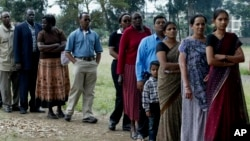 FILE - Members of a Kenyan family of Asian origin stand in line to cast their vote in Nairobi, Kenya, Dec. 27, 2007. On July 21, Kenya officially recognized Kenyan nationals of Asian descent as the country's 44th tribe.