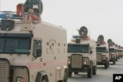 Saudi Arabian troops cross the causeway leading to Bahrain in this still image taken from video, March 14, 2011.