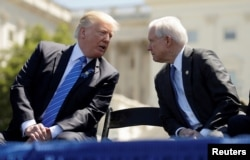 FILE - President Donald Trump speaks with Attorney General Jeff Sessions as they attend the National Peace Officers Memorial Service on the West Lawn of the U.S. Capitol in Washington.