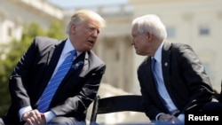 FILE - President Donald Trump speaks with Attorney General Jeff Sessions as they attend the National Peace Officers Memorial Service on the West Lawn of the U.S. Capitol in Washington, May 15, 2017.