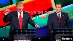 Republican U.S. presidential candidate businessman Donald Trump (L) speaks as Senator Ted Cruz (R) looks on during the Republican presidential debate in Las Vegas, Nevada, Dec. 15, 2015.