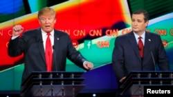 FILE - Republican U.S. presidential candidate businessman Donald Trump (L) speaks as Senator Ted Cruz looks on during the Republican presidential debate in Las Vegas, Nevada, Dec. 15, 2015.