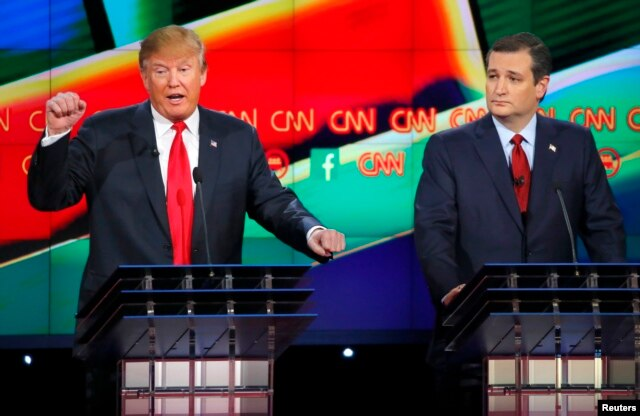 FILE - Republican U.S. presidential candidate businessman Donald Trump (L) speaks as Senator Ted Cruz (R) looks on during the Republican presidential debate in Las Vegas, Nevada, Dec. 15, 2015.