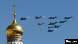 FILE - Russian military planes are see flying above the Kremlin.