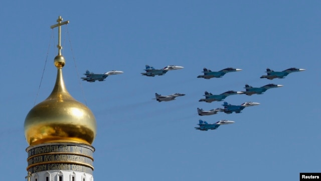 FILE - Russian military planes fly above the Kremlin.