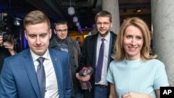 From the left: Reform party Party's secretary-general Erkki Keldo, Sven Mikser from Social Democrates, Jevgeni Ossinovski, leader of Social Democrates and Kaja Kallas pose for a photo after parliamentary elections in Tallinn, Estonia, early March 4, 2019.