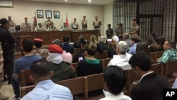A military court convenes in the case of a Jordanian soldier accused of shooting to death three U.S. military trainers at the gate of an air base, in Amman, Jordan, July 17, 2017.