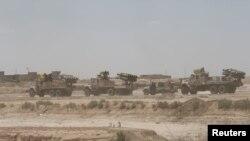 ພວກນັກລົບ Shi'ite ເຕົ້າໂຮມກັນຢູ່ໃກ້ກັບເມືອງ Falluja ປະເທດ Iraq.