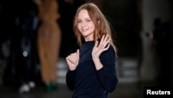 FILE - British designer Stella McCartney appears at the end of her Fall/Winter 2017-2018 women's ready-to-wear collection show during Paris Fashion Week, in Paris, March 6, 2017.