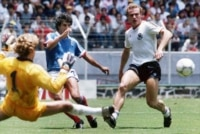 German goalkeeper Harald Schumacher, left, and defender Hans-Peter Briegel, right, stop France's William Ayache during the Football World Cup Semi-Final in Guadalajara, Mexico, on June 25, 1986.