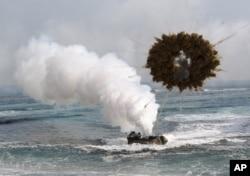 FILE - A South Korean marine LVT-7 landing craft sailing through a smoke screen during joint U.S.-South Korean exercises.