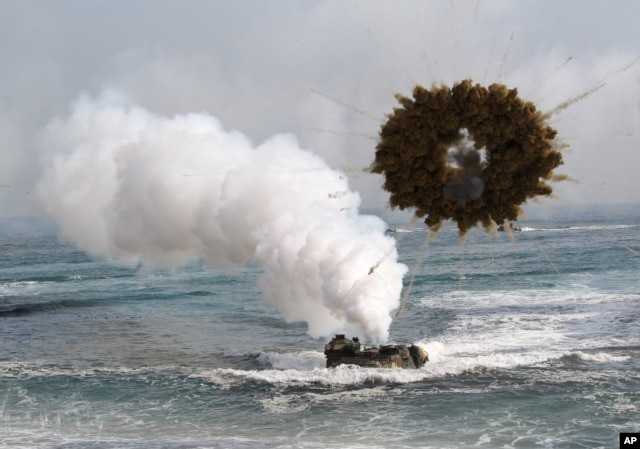 FILE - A South Korean marine LVT-7 landing craft sailing through a smoke screen during joint U.S.-South Korean exercises.
