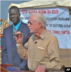 Feb. 11, 2010. Molujore Village, Terekeka County, Southern Sudan. Former U.S. President Jimmy Carter traveled to the remote Southern Sudan village of Molujore on Feb.11, 2010 to congratulate the community on the progress being made to eliminate the water