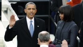 U.S. President Barack Obama is sworn in by Supreme Court Chief of Justice John Roberts, as first lady Michelle Obama looks on during inauguration ceremonies in Washington, D.E., January 21, 2013.