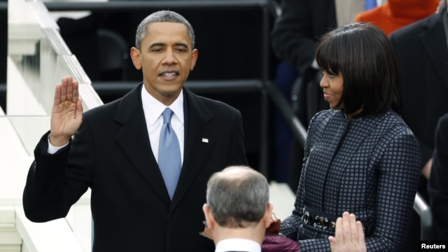 U.S. President Barack Obama is sworn in by Supreme Court Chief of Justice John Roberts, as first lady Michelle Obama looks on during inauguration ceremonies in Washington, D.C., January 21, 2013.