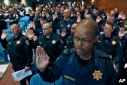 Over 300 officers from other jurisdictions, including many from the California Highway Patrol, are sworn in to have police powers in Cleveland, as preparations continue for the Republican National Convention in Cleveland, Ohio, July 16, 2016.