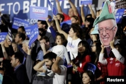 FILE - Supporters gather to see U.S. Democratic presidential candidate Bernie Sanders speak during a election night rally in Santa Monica, California, June 7, 2016.