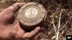 A volunteer deminer takes a landmine from the ground in Daraa, Syria. (File)
