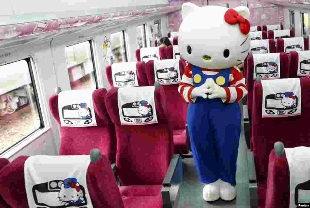 A performer dressed as a Hello Kitty poses inside a Hello Kitty-themed Taroko Express train in Taipei, Taiwan.