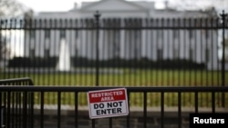 FILE - A restricted area sign is seen outside of the White House in Washington on Nov. 27, 2015.