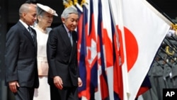Cambodian King Norodom Sihamoni, left, follows Japanese Emperor Akihito, right, and Empress Michiko, center, on their way to a welcoming ceremony at the Imperial Palace, in Tokyo, Japan, file photo.