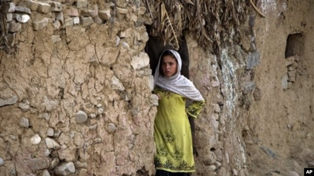 An Afghan refugee girl outside her home in slums of Islamabad, Pakistan, May 16, 2012.