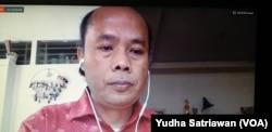 Direktur Migrant Care, Wahyu Susilo dalam tangkapan layar saat menjadi narasumber diskusi daring bertema DESBUMI, Rabu (17/6). (Foto: VOA/ Yudha Satriawan)