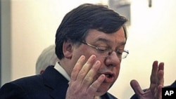 Irish Prime Minister Brian Cowen reacts during a press conference at government buildings in Dublin, Ireland, regarding a massive EU-IMF bailout, 22 Nov 2010