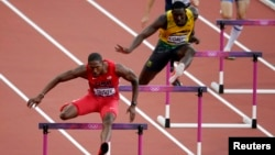 Michael Tinsley of the U.S. (L) and Jamaica's Leford Green clear hurdles during the men's 400m hurdles in London in 2012.