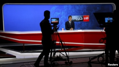 A cameraman films a news anchor at Tolo News studio, in Kabul, Afghanistan, Oct. 18, 2015.