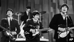 "FILE - The Beatles perform on CBS' ""Ed Sullivan Show"" in New York, Feb. 9, 1964."