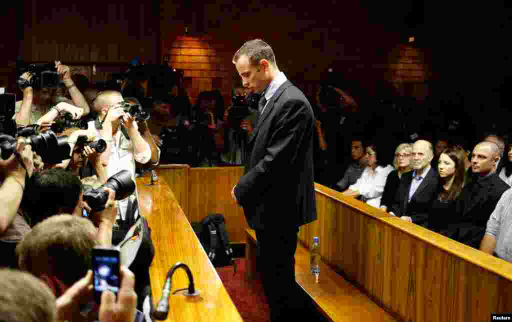 Oscar Pistorius stands at the dock before the start of proceedings, February 22, 2013.