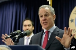 FILE - Two weeks after officials in 24 states asked Donald Trump to kill one of President Barack Obama's plans to curb global warming, New York Attorney General Eric Schneiderman was the lead author on a rebuttal letter signed by Democratic attorneys general in 15 states, plus four cities and counties, asking the president-elect to save it.