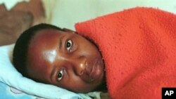 25-year-old South African, Lawrence Jet who is HIV-positive lies on his bed (file photo)
