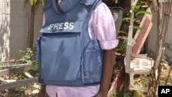 FILE - In this photo taken March 22, 2014, a Somali journalist is seen in Mogadishu, Somalia.