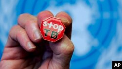 "File - A pin reading ""Stop TB"" is shown after presentation of WHO report Global Tuberculosis Control at the United Nations headquarters, Geneva, Switzerland."
