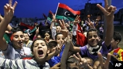 Libyan children celebrate in Souk el-Juma district in Tripoli, Libya, Oct. 21, 2011.