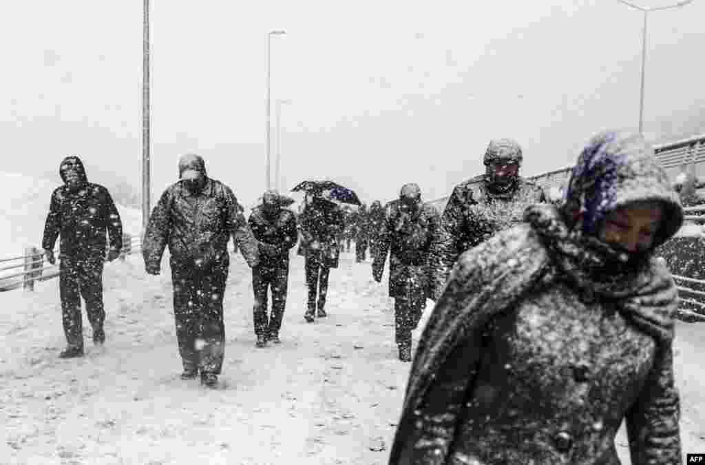 People walk during heavy snowfall in Istanbul, Turkey.