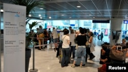 Passengers at an Air France ticketing counter at the Nice Cote d'Azur international airport in Nice, Sept. 27, 2014.
