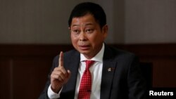 FILE - Indonesian Minister of Energy and Mineral Resources Ignasius Jonan gestures during an interview at his office in Jakarta, Aug. 22, 2017.