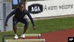 U.S. runner Lauryn Williams trains for the 2012 Summer Olympics, in Birmingham, England, July 23, 2012.
