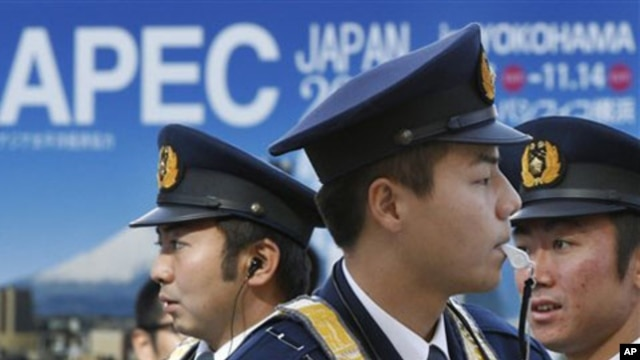 Police officers guard at a checkpoint to the enclosure of the APEC forum venue in Yokohama, near Tokyo as ministerial level meetings started in the day ahead of the Nov. 13-14 leaders' summit, 10 Nov 2010.