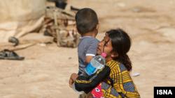 تصویری از کودکان سیلزده «حمیدیه» در خوزستان
