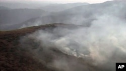 An image taken from an Inter Services Public Relations video shows smoke billowing from army posts after a NATO attack in the Pakistan-Afghanistan border area, November 30, 2011