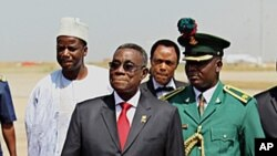 Ghana's President John Atta Mills (front, C) is up for re-election in the upcoming December vote (file photo).