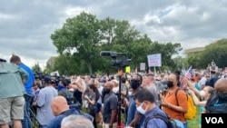 """Protesters are seen at the """"Justice for J6"""" rally at the U.S. Capitol, on Capitol Hill in Washington, Sept. 18, 2021. (Carolyn Presutti/VOA)"""