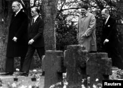 FILE German Chancellor Helmut Kohl walks with retired German Air Force General Johannes Steinhoff (frt) and former President Ronald Reagan accompanied by retired U.S. General Matthew Ridgway through the German military cemetary in Bitburg, May 5 1985.